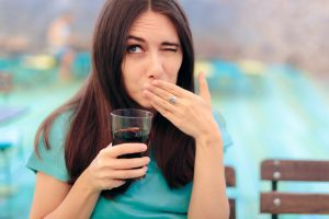 a lady experiencing tooth sensitivity
